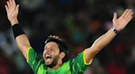Pakistan cricketer Shahid Afridi celebrates after he dismissed Sri Lankan cricketer Chamara Kapugedera during the second and final Twenty20 match between Sri Lanka and Pakistan at the Suriyawewa Mahinda Rajapakse International Cricket Stadium in the southern district of Hambantota