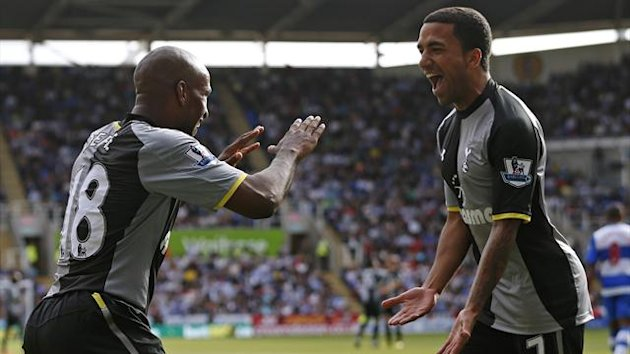 Tottenham Hotspur's Jermaine Defoe (L) celebrates his goal against Reading with Aaron Lennon during their English Premier League match at the Madejski Stadium in Reading (Reuters)