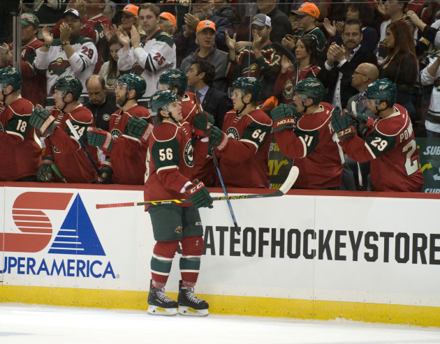 Oct 25, 2014; Saint Paul, MN, USA; Minnesota Wild forward Erik Haula (56) celebrates his goal during the first period against the Tampa Bay Lightning at Xcel Energy Center. (Marilyn Indahl-USA TODAY Sports)