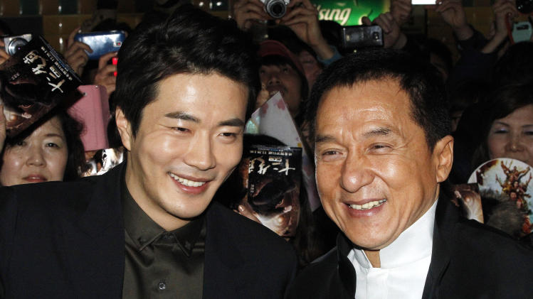 CORRECTS YEAR - Hong Kong actor and director Jackie Chan, right, and South Korean actor Kwon Sang-woo smile during a promotional event for their latest movie, CZ12, or Chinese Zodiac, in Seoul, South Korea, Monday, Feb. 18, 2013.(AP Photo/Ahn Young-joon)