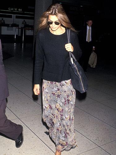 Cindy Crawford arriving at LAX in a floral maxi skirt, 1994