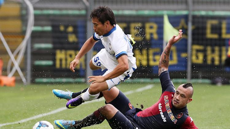 Inter Milan defender Yuto Nagatomo, left, is tackled by Cagliari's Radja Nainggolan, during the Serie A soccer match between Cagliari and Inter, at the Nereo Rocco Stadium in Trieste, Italy, Sunday, Sept. 29, 2013