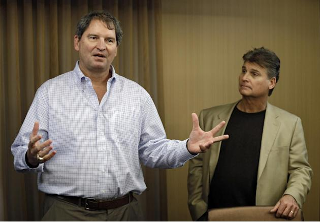 In this Jan. 10, 2013 file photo, former Cleveland Browns quarterback Bernie Kosar, left, speaks at a news conference with Dr. Rick Sponaugle, in Middleburg Heights, Ohio . Thursday, Jan. 10, 2013. Ko