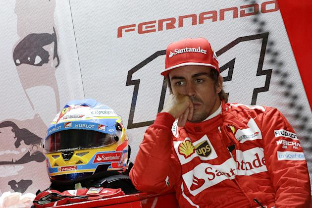 Ferrari driver Fernando Alonso of Spain waits in the garage during the practice session ahead of Sunday's Chinese Formula One Grand Prix at Shanghai International Circuit in Shanghai, China, Satur