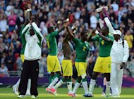 Senegal's players celebrate after winning their football match against Uruguay during the 2012 London Olympic Games at Wembley Stadium in London. Senegal won 2-0