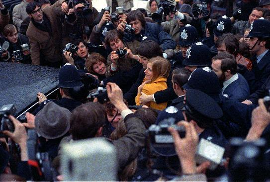 FILE - In this March 12, 1969 file photo newlyweds Paul and Linda McCartney are surrounded by photographers as police escort the couple to their car after they were married at the registry office in London. Paul McCartney turned 70 years of age Monday June 18, 2012. (AP Photo/File)