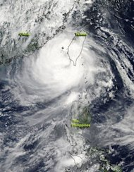 Image provided by NASA shows Typhoon Tembin after it had crossed southern Taiwan and re-emerged into the waters of the Philippine Sea on August 24. On its current track, Tembin was forecast to make landfall again in Pingtung and move northward off the east coast