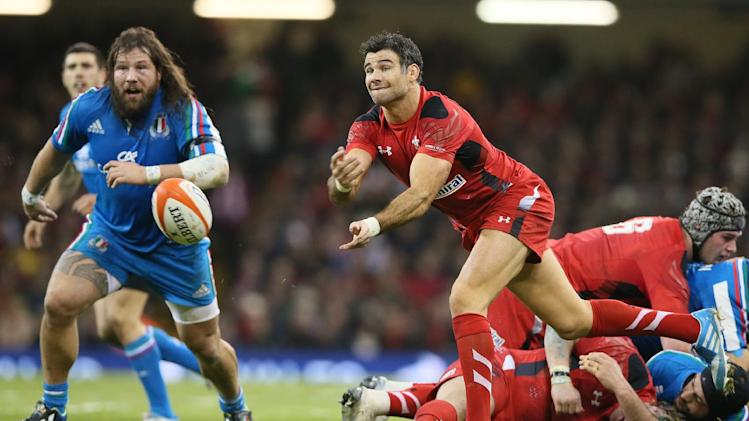 Wales's Mike Phillips passes the ball out from a scrum during their Six Nations international rugby union match between Wales and Italy at the Millennium stadium in Cardiff, Wales, Saturday, Feb. 1, 2014