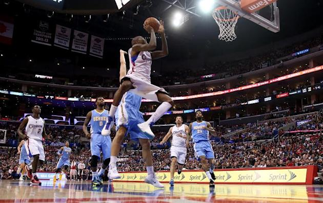 Jamal Crawford of the Los Angeles Clippers shoots during their NBA games against the Denver Nuggets at Staples Center on April 15, 2014
