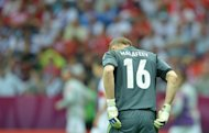 Russian goalkeeper Vyacheslav Malafeev is pictured during the Euro 2012 championships football match Poland vs Russia on June 12, 2012 at the National Stadium in Warsaw. AFP PHOTO / NATALIA KOLESNIKOVANATALIA KOLESNIKOVA/AFP/GettyImages