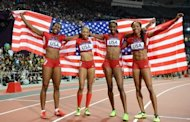 (L-R) Americans Francena McCorory, Allyson Felix, Deedee Trotter and Sanya Richards-Ross celebrate after winning the women's 4x400m relay final at the London Olympics on August 11. US women won 29 of America's medals-table-leading 46 golds
