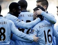 Manchester City's players celebrate scoring a goal against Newcastle United during their English Premier League match at St James Park, Newcastle upon Tyne, on December 15, 2012. City's bid to reel in league leaders Man United has been jeopardised by injuries to key players as they prepare to open their Christmas campaign at home to Reading on Saturday