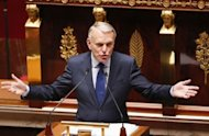"French Prime Minister Jean-Marc Ayrault addresses Members of Parliament at the National Assembly in Paris. Ayrault said that between 2007 and 2011, France's debt grew by 600 billion euros ""to nearly 1,800 billion euros today, or 90 percent of the wealth produced annually in France."""