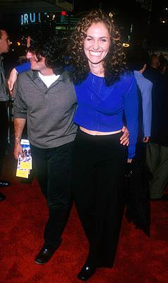 Premiere: Amy Brenneman and hubby at the Mann Village Theater premiere of Warner Brothers' Three Kings - 9/27/1999