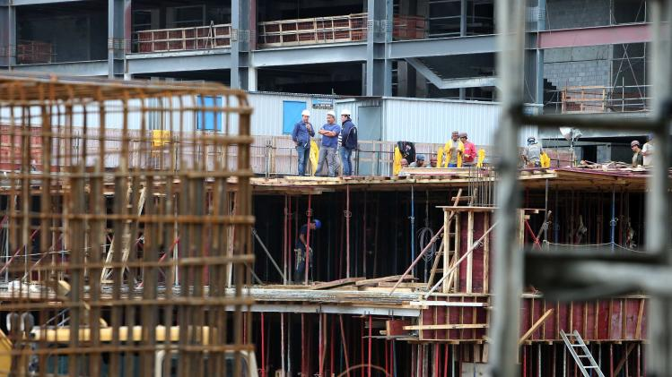 Workers are pictured at the Arena da Baixada soccer stadium as it is being built to host matches of the 2014 World Cup in Curitiba