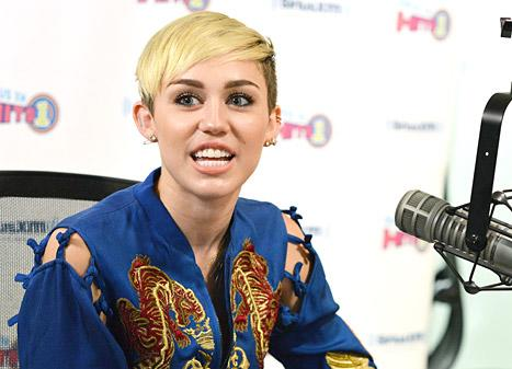 Miley Cyrus Wears Hair Down in Combover-Like Hairstyle