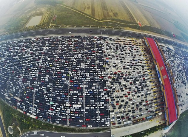 Vehicles are seen stuck in a traffic jam at the end of a week-long national holiday, in Beijing, China.