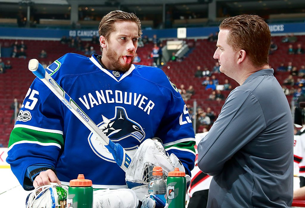 VANCOUVER, BC - JANUARY 15: Vancouver Canucks trainer Brian Hamilton checks the tongue of Jacob Markstrom #25 of the Vancouver Canucks during their NHL game against the New Jersey Devils at Rogers Arena January 15, 2017 in Vancouver, British Columbia, Canada. New Jersey won 2-1 in overtime. (Photo by Jeff Vinnick/NHLI via Getty Images)