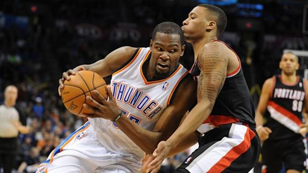 Oklahoma City Thunder small forward Kevin Durant (35) drives the ball by Portland Trail Blazers point guard Damian Lillard (0) (Reuters)