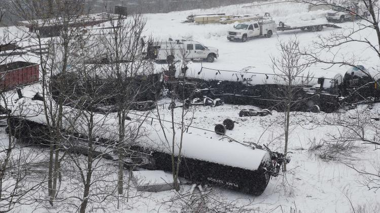 Wreckage of a train derailment is seen in the snow near Vandergrift