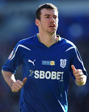 Doncaster have signed former Cardiff defender Paul Quinn on a one-year deal