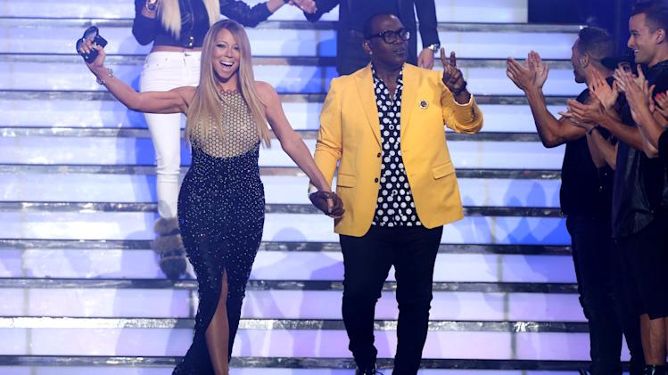 "Judges Mariah Carey, left, and Randy Jackson walk on stage at the ""American Idol"" finale at the Nokia Theatre at L.A. Live on Thursday, May 16, 2013, in Los Angeles. (Photo by Matt Sayles/Invision/AP)"