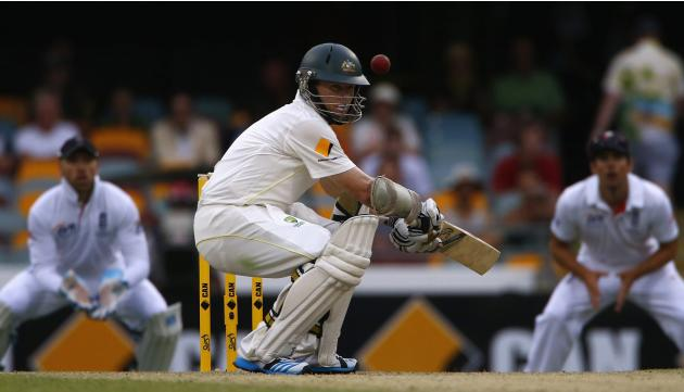 Australia's Rogers avoids a high delivery from England's Broad during the second day's play of the first Ashes cricket test in Brisbane