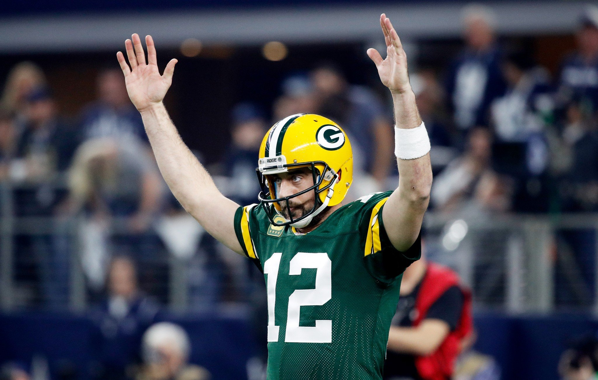 Aaron Rodgers #12 of the Green Bay Packers reacts after scoring a touchdown in the first half during the NFC Divisional Playoff Game against the Dalla...