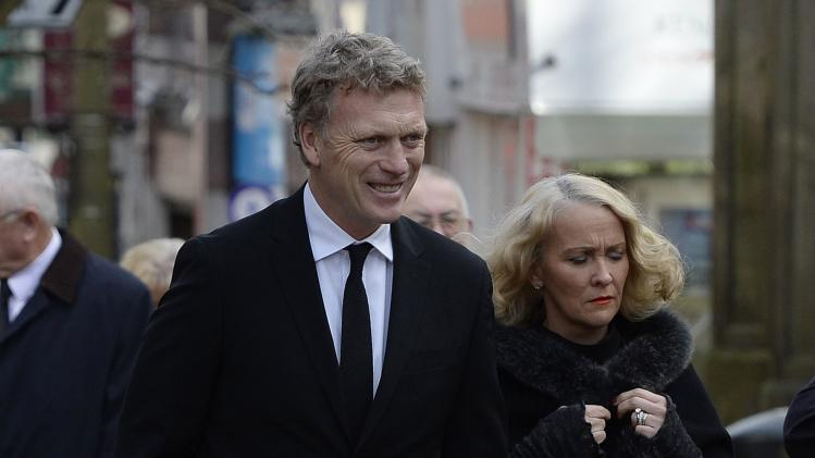 Manchester United's manager Moyes and his wife Pamela arrive for the funeral of former Preston and England soccer player Finney at Preston Minster