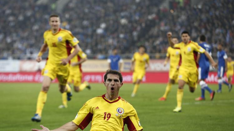 Romania's Bogdan Stancu celebrates a goal against Greece during their 2014 World Cup qualifying playoff first leg soccer match at Karaiskaki stadium in Piraeus