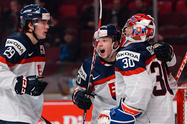 Matej Paulovic #29 of Team Slovakia celebrates a victory over team Finland with teammates Martin Reway #10 and Denis Godla #30. (Photo by Minas Panagiotakis/Getty Images)