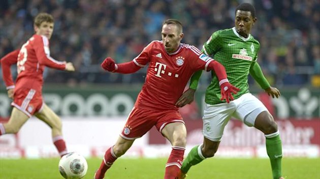 Werder Bremen's Cedric Makiadi (R) and Bayern Munich's Franck Ribery (C) fight for the ball (Reuters)