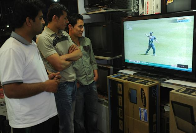 Afghan cricket fans watch a live broadca