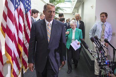 House Speaker John Boehner of Ohio, followed by Rep. Virginia Foxx, R-N.C., and others, arrives for a news conference on Capitol Hill, in Washington, ...