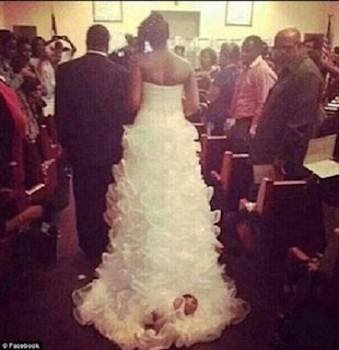 Bride straps baby to dress