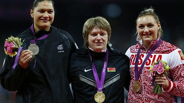 Gold medallist Belarus' Nadzeya Ostapchuk, silver medallist New Zealand's Valerie Adams (L) and bronze medallist Russia's Evgeniia Kolodko (R) hold their medals in the women's shot put victory ceremony (Reuters)