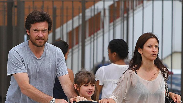 Jason Bateman and wife Amanda Anka walk with their daughters in NYC