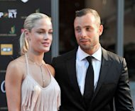 South Africa's Olympic sprint star Oscar Pistorius and his model girlfriend Reeva Steenkamp are seen at Feather Awards in Johannesburg on November 4, 2012. Steenkamp, who was allegedly shot dead by Pistorius, will appear in a pre-recorded celebrity reality TV show in South Africa, two days after her death shocked the nation and the world