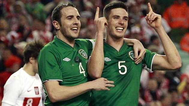 Ireland's Ciaran Clark (R) is congratulated by team mate John O'Shea (4) after scoring against Poland during their friendly international soccer match at the Aviva Stadium in Dublin February 6, 2013. (Reuters)