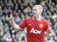 Manchester United's Paul Scholes (L) celebrates after scoring a goal during the Premier League match against Norwich City on 26 February. Scholes had given United an early lead but that was cancelled out in the 83rd minute by a fine strike by Norwich captain Grant Holt