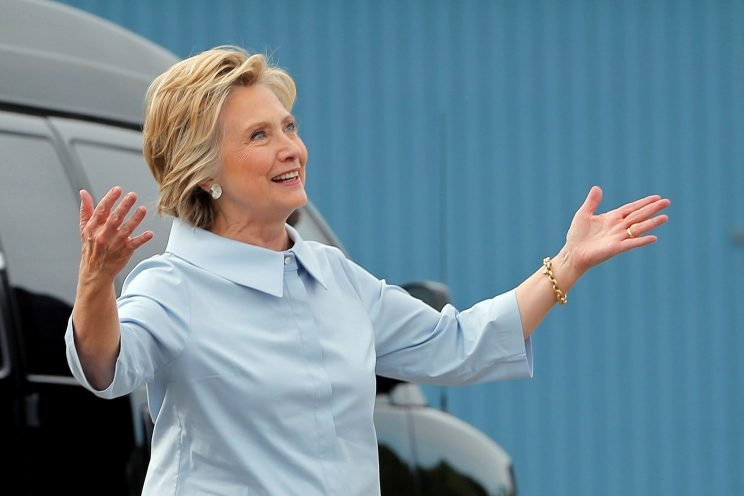 Democratic presidential nominee Hillary Clinton reacts to her newly unveiled campaign plane before boarding for the first time at the Westchester County Airport in White Plains, N.Y. , on September 5, 2016. (REUTERS/Brian Snyder)