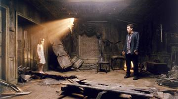 Jasmine Jessica Anthony and John Cusack in Dimension Films' 1408