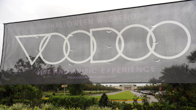 FILE-  This Wednesday, Oct. 28, 2009 file photo shows a large sign in front of the New Orleans Museum of Art in City Park welcoming music lovers for the Voodoo Art and Music Experience during Halloween weekend in New Orleans. The three-day festival begins Friday, Oct. 26, 2012, at New Orleans City Park, and this will be the first year tent-camping will be available for concert-goers _ a popular stable at European music festivals.   (AP Photo/Cheryl Gerber, file)