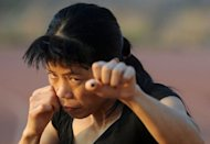 "Indian boxer MC Mary Kom at a training session at the Balewadi Sports Complex in Pune, western India, in April 2012. From her beginnings as a poor farmers' daughter in a remote and troubled corner of India, ""Magnificent Mary"" has fought her way up to become five-times world boxing champion"