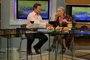 """Cougar Town's'"" Busy Philipps enjoys a little taste of Big Carl II's contents as she co-hosts Access Hollywood Live with Billy Bush, July 28, 2011 -- Access Hollywood"