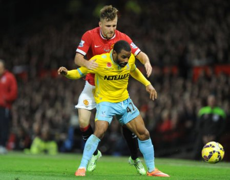 Manchester United's Luke Shaw (back) and Crystal Palace's Jason Puncheon battle for the ball