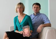 Kate and Gerry McCann, whose daughter Madeleine went missing from her family's holiday flat in the Algarve shortly before her fourth birthday in 2007, pose with their book 'Madeleine' on September 16, 2011 at a hotel in Hamburg. Portuguese authorities have said they have no new evidence that would give them cause to reopen an inquiry into the disappearance of Madeleine