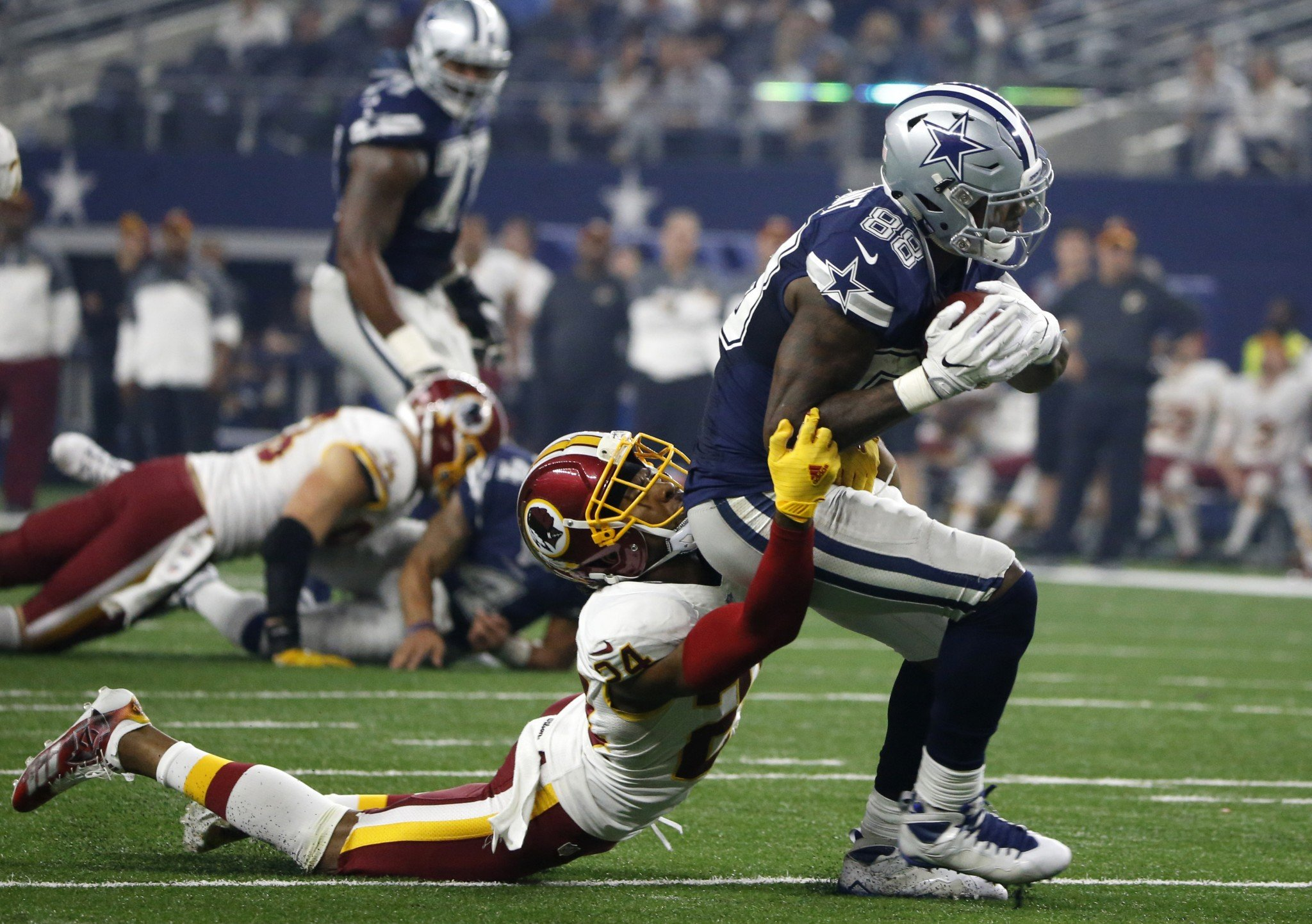 Dez Bryant, right, and Josh Norman were calm early but feisty late on Thanksgiving. (AP)