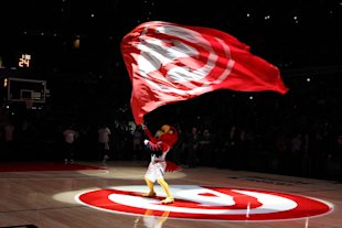 Harry Hawk waves a flag before a game against the Sacramento Kings at Philips Arena. (Brett Davis-USA TODAY Sports)