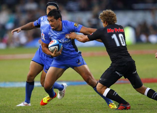 Coastal Sharks' Pat Lambie tackles Western Force's Alfie Mafi (L) during the Super 15 Rugby Union match between Western Force of Australia and Coastal Sharks from Durban at the Kings Park in Durban on